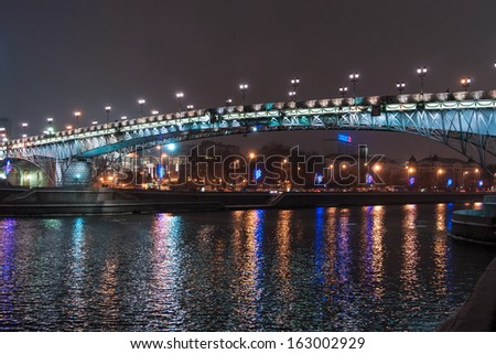 the foot bridge through Moscow the river near the Cathedral of Christ the Saviour at night - stock photo