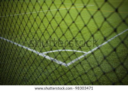 The football field (soccer) with a white mesh football field - stock photo