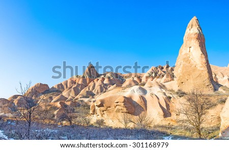 The footpath in the Rose Valley runs along the colorful rocks with unusual shapes and different sizes, Cappadocia, Turkey.