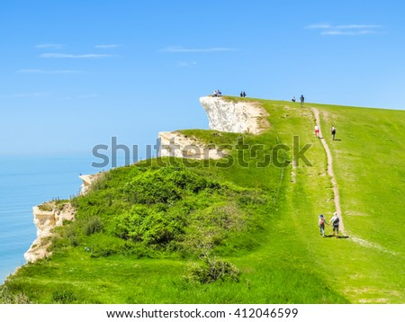 The footpath on a white chalk cliffs near Eastbourne. East Sussex, England - stock photo