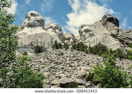 The forefathers on Mount Rushmore - George Washington, Thomas Jefferson, Theodore Roosevelt, and Abraham Lincoln - overlook the Black Hills of South Dakota. - stock photo