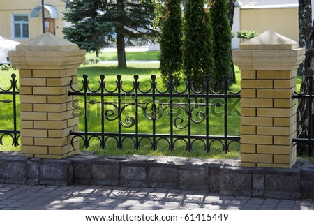 The Forged decorative fence with element litho. - stock photo