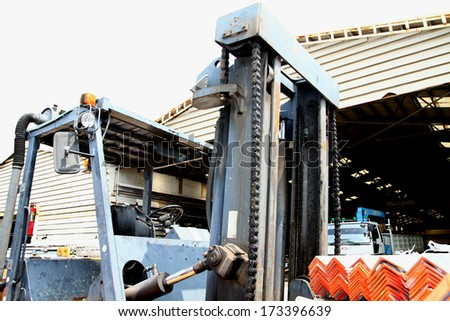 The forklift in steel warehouse - stock photo