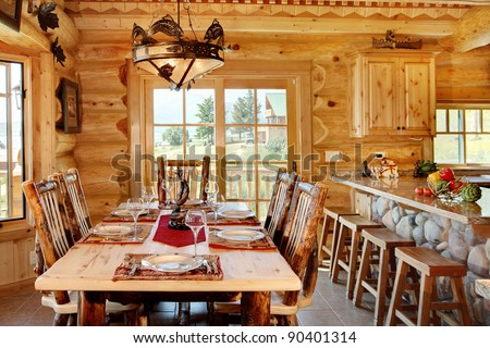 The Formal Dining Room In A Modern Log Cabin. The Table Is Set And Ready
