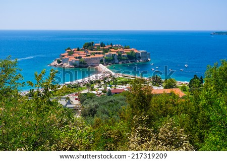 The former fishing village located on the stone islet became the luxury resort with cozy sand beaches and shady gardens, Sveti Stefan, Montenegro. - stock photo