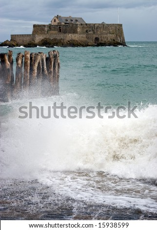 "The ""Fort National"" in Saint-Malo, France during stormy seas. - stock photo"