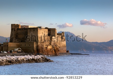 The fort of Castl dell' Ovo in Naples, Italy, towering over the bay of Naples with the Vesuvius volcano in the distance