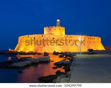 The Fort of Saint Nicholas that guards the Mandraki Harbour, Rhodes Greece - stock photo