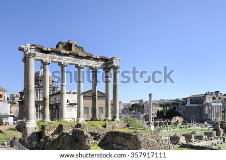 The Forum Romanum with at left foreground theTemple of Saturn.Behind the temple the Arch of Septimius Severus and the Church of Santi Luca e Martina  - stock photo