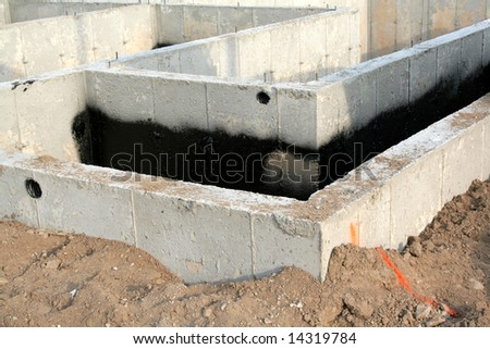 The foundation of a new townhouse. - stock photo