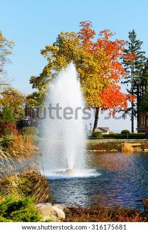 The fountain and rainbow in Mezhigirya, Ukraine. It is former residence of ex-president Yanukovich - stock photo