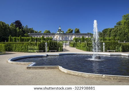 The fountain in the background of the palace Bildergalerie. Sanssouci is the most famous palace of Frederick the Great - stock photo