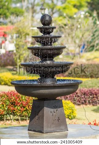 The fountain in the garden - stock photo