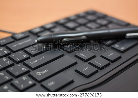 the fountain pen and computer keyboard - stock photo
