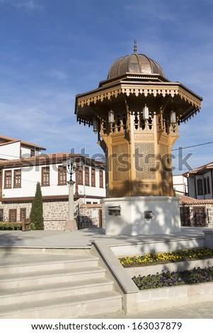 The fountain (Sebil) which is the same of Sebilj  in Sarajevo, capital city of Bosnia and Herzegovina, and historical Ankara houses, Ankara, Turkey  - stock photo