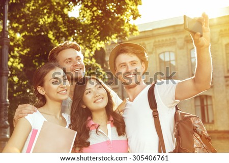 The four friends make beautiful self with your phone - stock photo