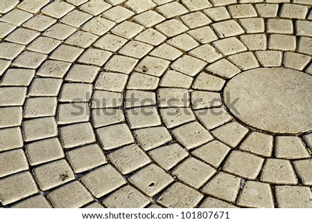 The fragment of a pavement in the form of a circle. - stock photo