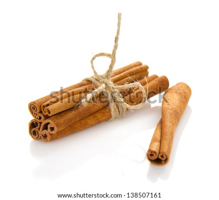 The fragrant sticks of cinnamon isolated on white - stock photo