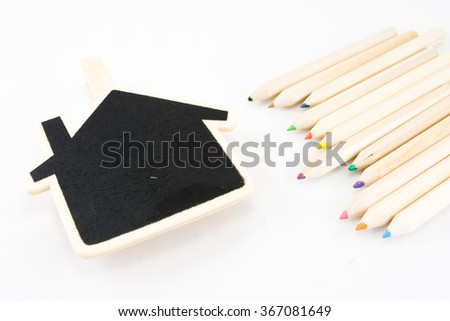 The frame as a house with color pencil on white background - stock photo