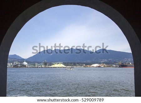 The framed view from Brockton Point Lighthouse to Vancouver Harbour (British Columbia).