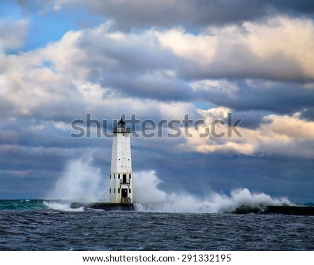 The Frankfort North Breakwater Light On A Stormy Morning In Michigan, USA - stock photo