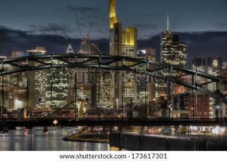 The Frankfurt Skyline behind the Deutschherrnbruecke (Railway Bridge)  - stock photo
