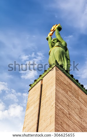 The freedom monument in the capital city of Riga in Latvia. - stock photo