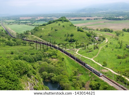 The freight train with coal moves along the trans-siberian railway (Primorsky region, Russia) - stock photo