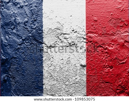 The French flag painted on grunge wall - stock photo