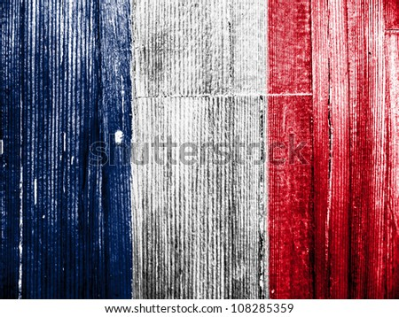 The French flag painted on wooden pad - stock photo