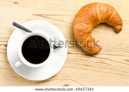 the fresh croissant with coffee - stock photo