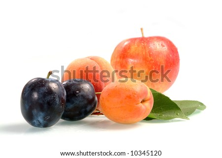 The fresh fruit covered by drops of water. Isolation on white. - stock photo