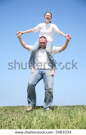 The friend holds the girlfriend in a white T-short - stock photo