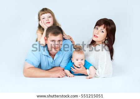 The friendly and young family with young children