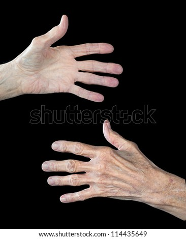 The front and back of an elderly woman's hands.  The subject has arthritis and shows clear signs of aging. - stock photo