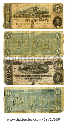 The front and back of two dirty, very worn five and ten dollar bills from the United States. Printed by the Confederate states in 1864 during the Civil War. Isolated on white. Clipping path included. - stock photo