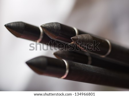 The front arrow heads of standard compound archery bow arrows. Shallow Depth of field - stock photo
