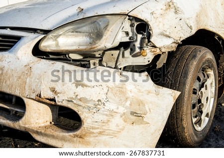 The front bumper of a crashed car. - stock photo