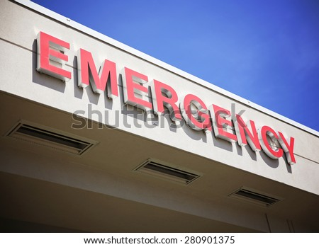 the front entrance sign to an emergency room department in a city hospital - stock photo