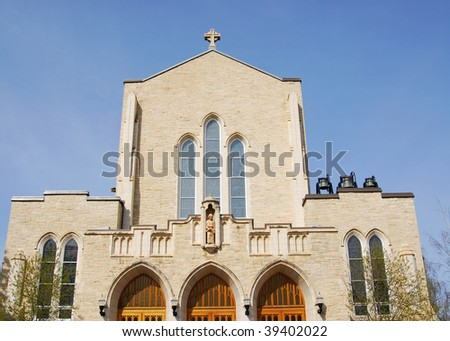 The front look of a historic catholic church in downtown Edmonton, Alberta, Canada - stock photo