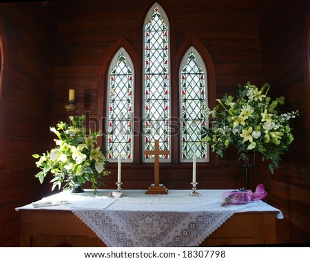 The front of a church showing the stained glass windows - stock photo