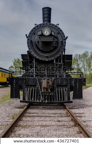 The front of an old railroad steam locomotive.