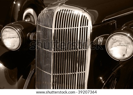 The front of black vintage car cabriolet - stock photo