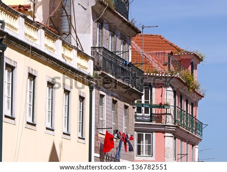 The front of some old houses in the center of Lisbon
