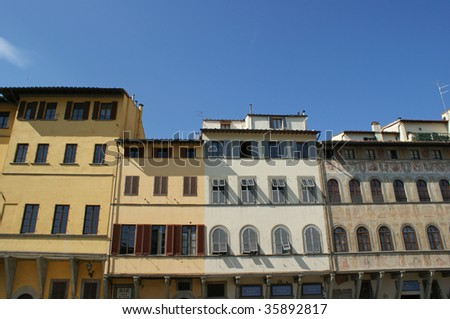 The front of some typically old houses in Florence - stock photo