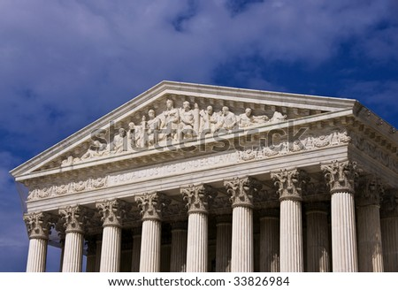 The front of the United States Supreme Court building in Washington DC. - stock photo