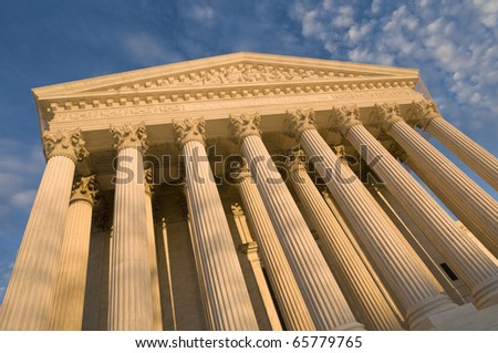 The front of the US Supreme Court in Washington, DC, at dusk. - stock photo