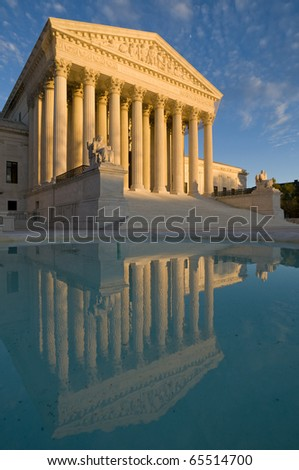 The front of the US Supreme Court in Washington, DC, at dusk. Completed in 1935, the US Supreme Court building in Washington, DC, is the first to have been built specifically for the purpose. - stock photo