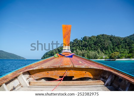 The front of wood boat on the sea - stock photo