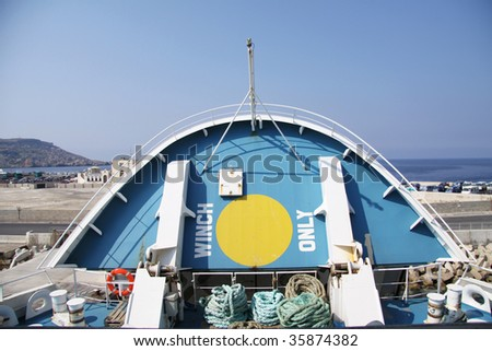the front part of a large passenger and car vessel being lowered to close the ship - stock photo